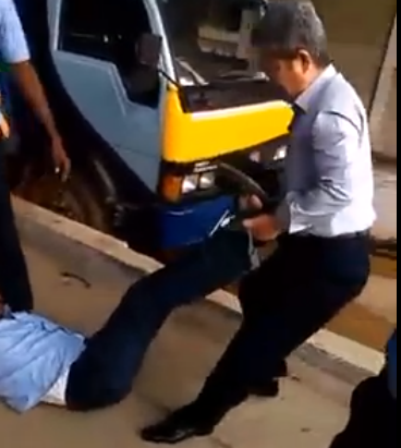 Worker Dragged by Company Official